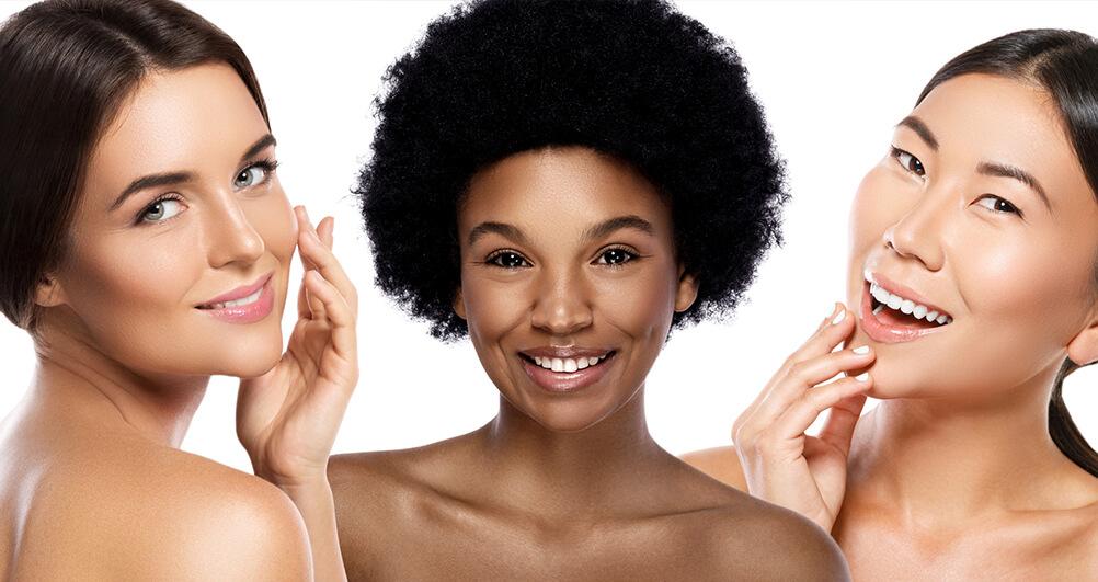 3 woman admiring their facial skin